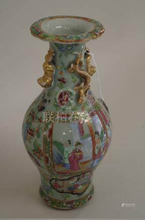 A Chinese Canton famille rose twin handled baluster vase,late 19th century, 24.5cm high.
