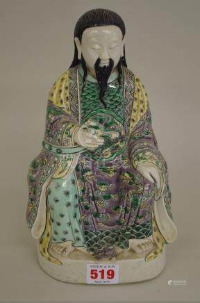 A Chinese famille verte seated figure,wearing dragon robes and with a tortoise at his feet, 25cm