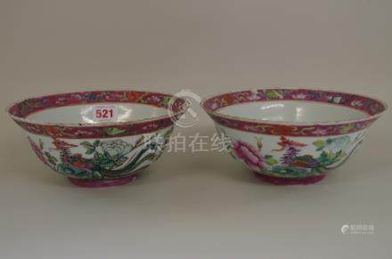A matched pair of Chinese famille rose phoenix bowls,Qianlong seal marks,20cm diameter, (2).