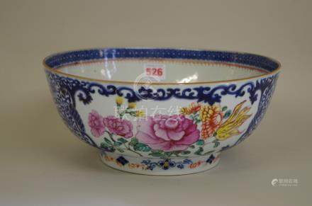 A Chinese famille rose circular bowl, late 18th century, painted with panels of flowers, 29cm