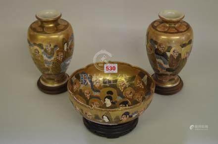 A pair of Japanese Satsuma vases,18.5cm high;together witha similar bowl, 19cm diameter, each