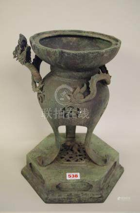 A Japanese bronze koro,with hexagonal base, the pierced body applied in high relief with a