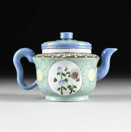A CHINESE YIXING POLYCHROME PALE GREEN GROUND ENAMELED TEAPOT AND COVER, IMPRESSED MARKS, 20TH