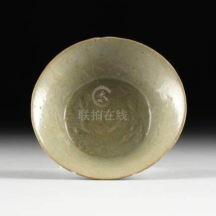 A CHINESE LONGQUAN TYPE CELADON GLAZED RELIEF CARVED EARTHENWARE BOWL, IN THE SONG DYNASTY (960-