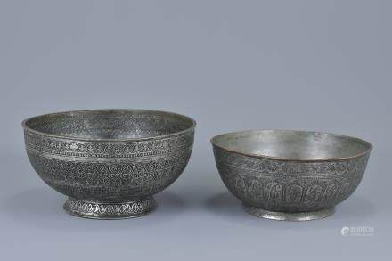 Two antique Persian metal bowls, one with mark and inscription. 19cm diameter