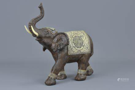 An Indian carved wooden elephant. 25cm x 24cm