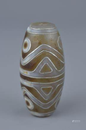 A Tibetan agate bead Tianzhu style inlaid with silver.