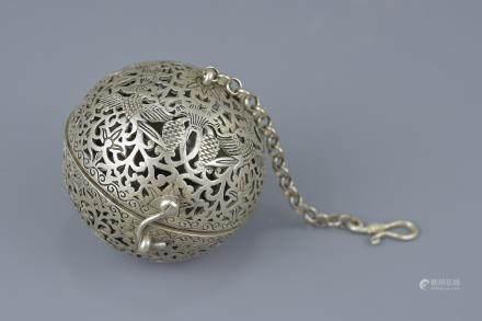 A Tibetan silver-plated incense prayer ball. 6cm diameter