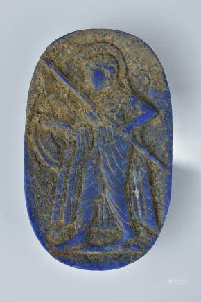 A lapis carving of a soldier with a spear. 7cm width