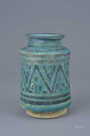 A Middle Eastern blue-glazed pottery vase possibly 12th century. 12cm height