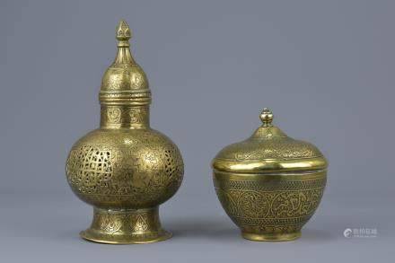 Two Islamic brass items with covers with pierced decoration and bowl with inscription. 18cm height