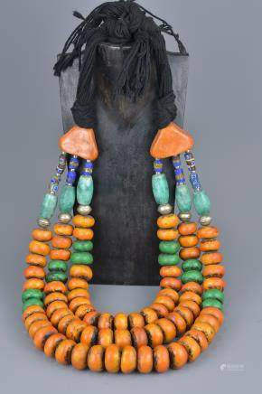 A large Moroccan amber resin and blue stone necklace.