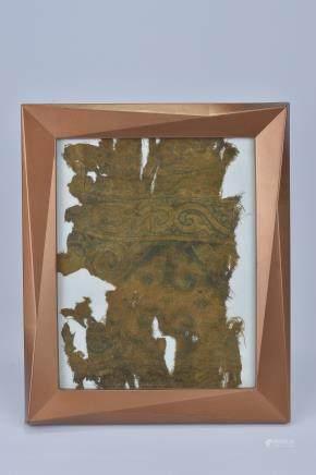 A framed Tibetan silk fragment. 31cm x 26cm