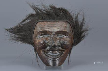 A large Japanese carved wooden ceremonial mask. 29cm x 25cm