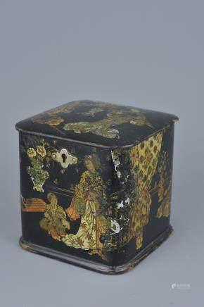 A Japanese lacquer Tea Caddy with Gold Gilding decorated with figures in garden. 11cm x 11cm