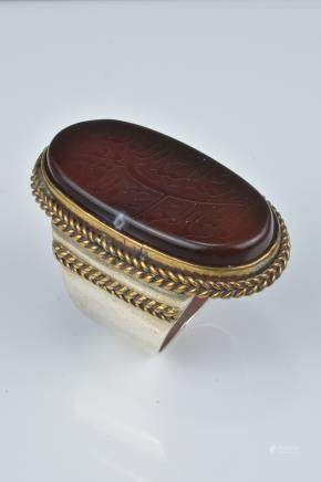 An Islamic agate stone ring with inscription.