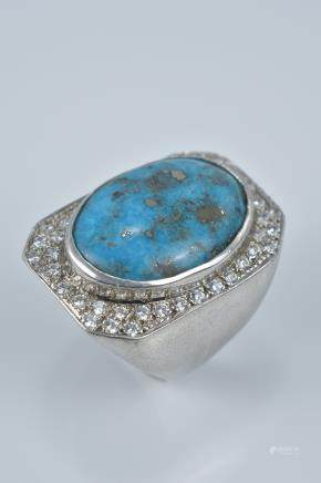 A large turquoise and silver ring stamped 925. Size R