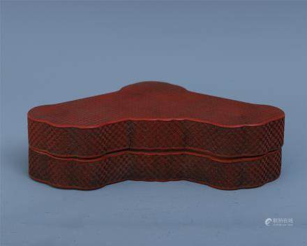 A Chinese Carved Cinnabar Lacquered Ruyi Box