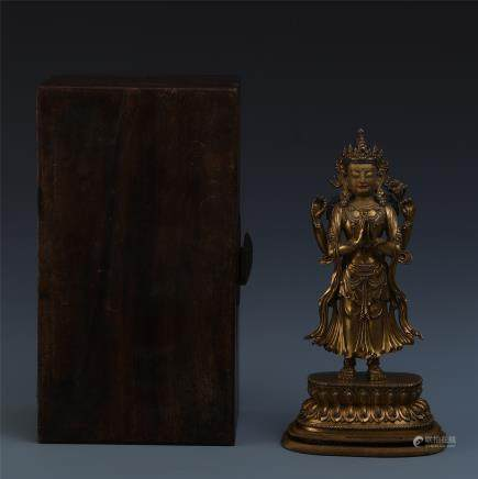 A Chinese Gilt Bronze Figure of Four-armed Guan Yin