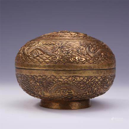 A Chinese Gilt Bronze Circular Box and Cover