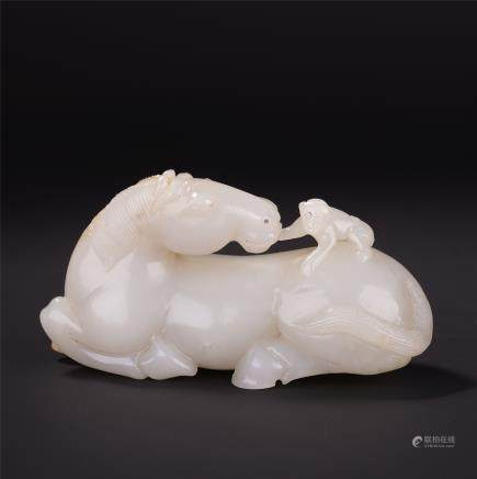 A Chinese White Jade Carving of Horse and Monkey""