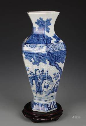 BLUE AND WHITE BOY PLAYING SIX SIDED VASE