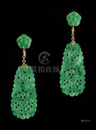 A pair of Chinese 18ct yellow gold & carved apple green untreated jadeite pendant earrings, with