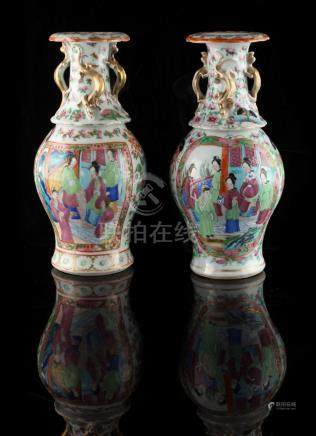 Property of a lady - a pair of 19th century Chinese Canton famille rose baluster vases, painted with