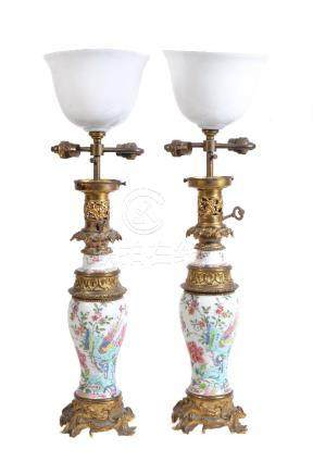 A pair of Chinese 'Famille Rose' gilt-metal mounted vases