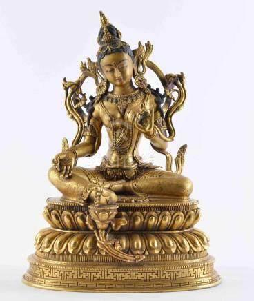 Figur der Sitatara, tibeto-chinesisch, wohl 19. Jhd.feuervergoldete Bronze teils farbig gefasst,