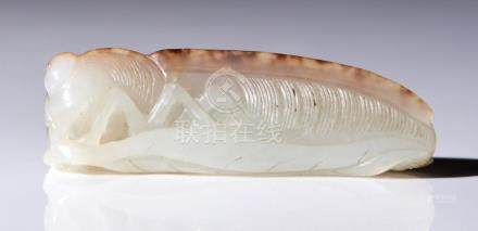 A CHINESE WHITE AND RUSSET JADE FIGURE OF A CICADA QING DYNA