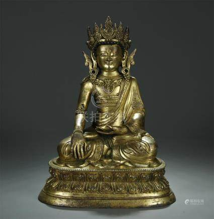 Large antique gilt bronze figure of Sakyamuni