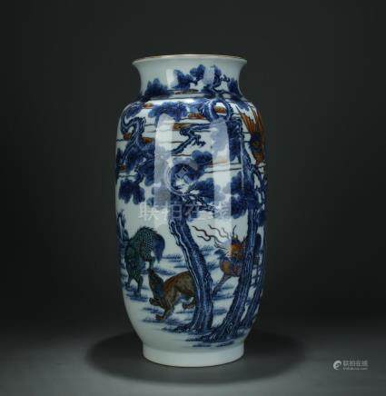 A large blue/white vase, marked