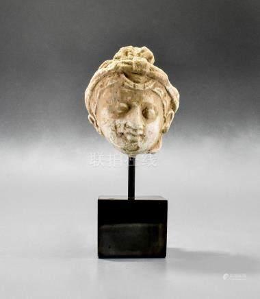 GANDHARA STUCCO HEAD OF BUDDHA ON STAND