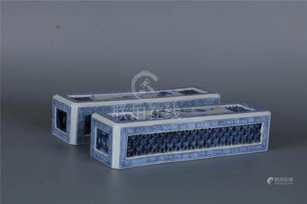 A PAIR OF CHINESE BLUE AND WHITE PORCELAIN PAPER WEIGHTS WIT