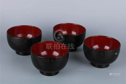 A GROUP OF FOUR LACQUERED WOOD BOWLS, QING DYNASTY