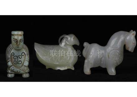 A GROUP OF THREE NEPHRITE JADE STATUES, HAN DYNASTY