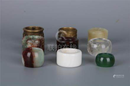 A GROUP OF NINE CHINESE THUMB-RINGS, QING DYNASTY