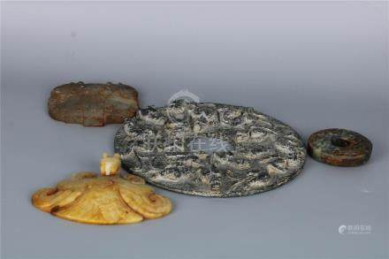 A GROUP OF FOUR CHINESE JADE DISC BIS, WARRING STATE PERIOD.