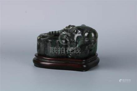 A CHINESE GREEN JADE SHEEP-SHAPED WATER POT WITH FITTED STAN