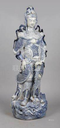 A large Chinese blue and white porcelain sculpture. Formed as a female warrior, clad in armour,
