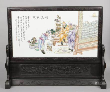 A very large Chinese 20th century floor standing scholars screen. With carved hardwood stand and