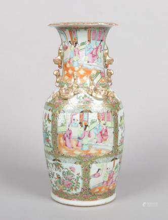 A 19th century Cantonese vase. Moulded with mythical beasts and lizards decorated in gilt, with