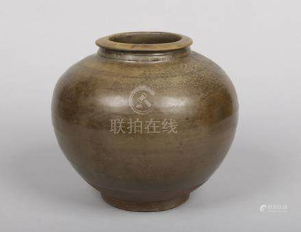 A Chinese Yuan dynasty earthenware jar decorated in tea dust glaze, 21.5cm.