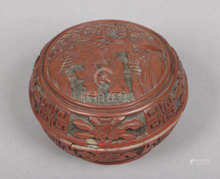 An 19th century Chinese cinnabar lacquer box and cover of circular form. Carved to depict a sage and