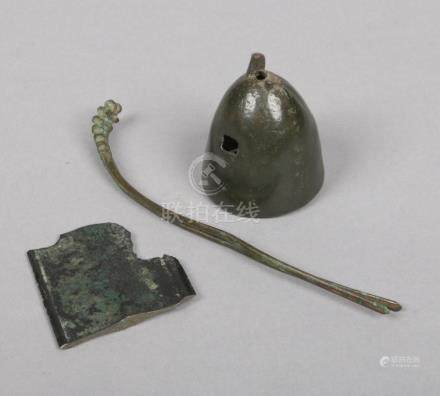 Tang and Han dynasty excavated bronze finds. A bell, hair pin and a section of a sword blade.