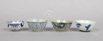 Two Chinese provincial Ming dynasty blue and white bowls and two similar Oriental porcelain bowls.
