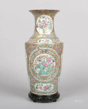 A 19th century Cantonese vase on hardwood plinth. Gilt ground with fruit, flowers and butterflies