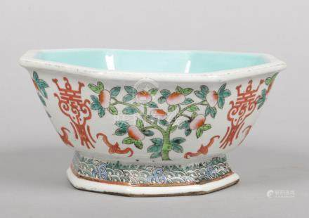 A Chinese famille verte octagonal bowl. With turquoise interior and painted with peaches, fruit bats