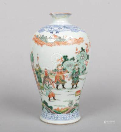 A Chinese famille verte meiping vase. Painted with an underglaze blue lambrequin collar and with a